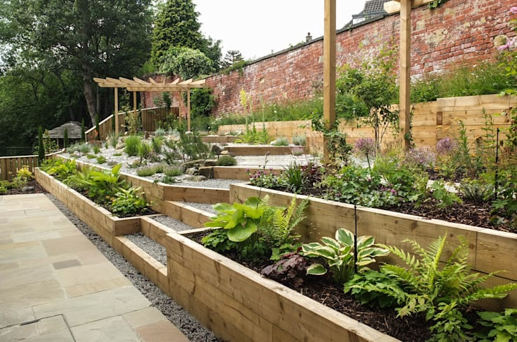 Modern Garden with a rustic twist:  Garden by Yorkshire Gardens