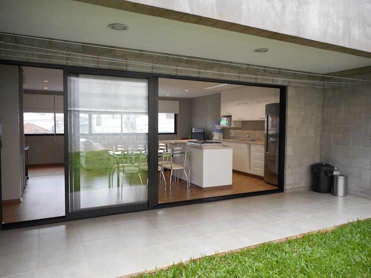 บ้านและที่อยู่อาศัย by Metamorfose Arquitetura e Urbanismo