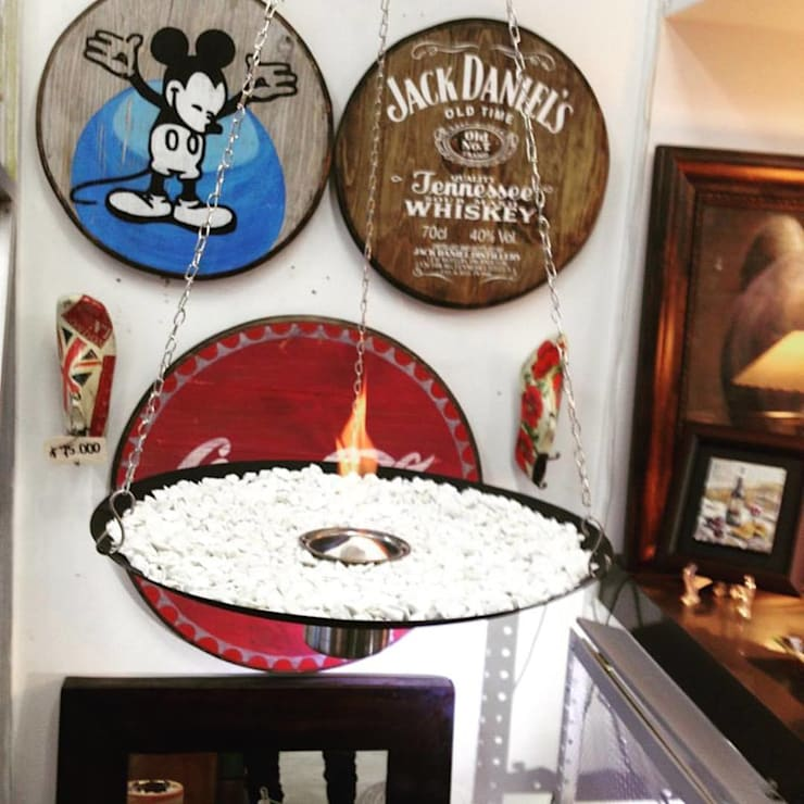 Chimenea decorativa pendulo: Salones de estilo  por Abasto de Diseño