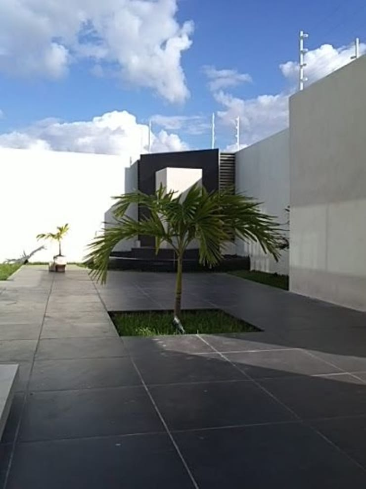 AD.GOGUE: Jardines de estilo  por Base cubica Arquitectos