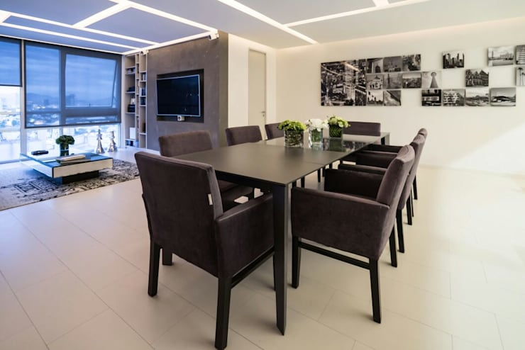 Comedores de estilo moderno por HO arquitectura de interiores