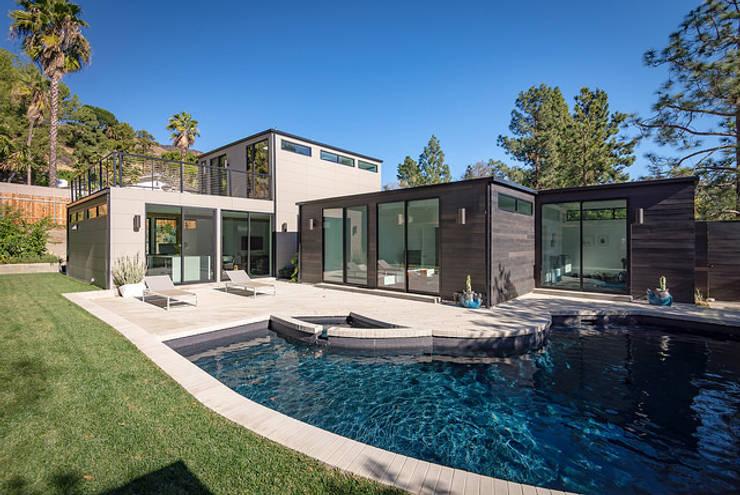 Casas prefabricadas de estilo  por Construcciones F. Rivaz