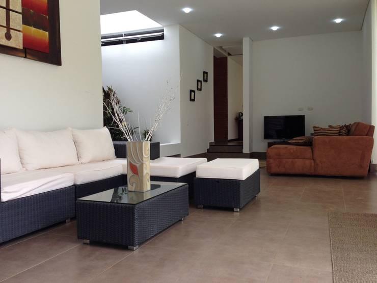 Casa Dapa AN: Salas de estilo  por COLECTIVO CREATIVO