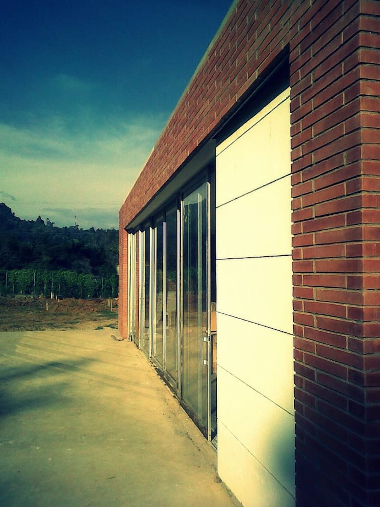 Casa Dapa AN: Casas de estilo  por COLECTIVO CREATIVO