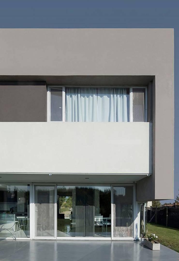 Casa M: Casas de estilo  por DMS Arquitectura