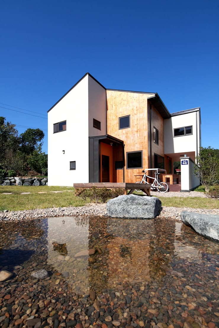 주간전경: 주택설계전문 디자인그룹 홈스타일토토의  주택,모던 우드 우드 그레인