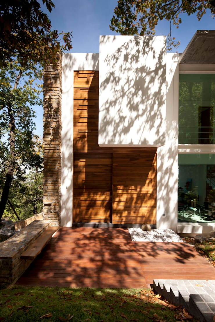Casa Olinala - Local 10 Arquitectura: Casas de estilo  por Local 10 Arquitectura