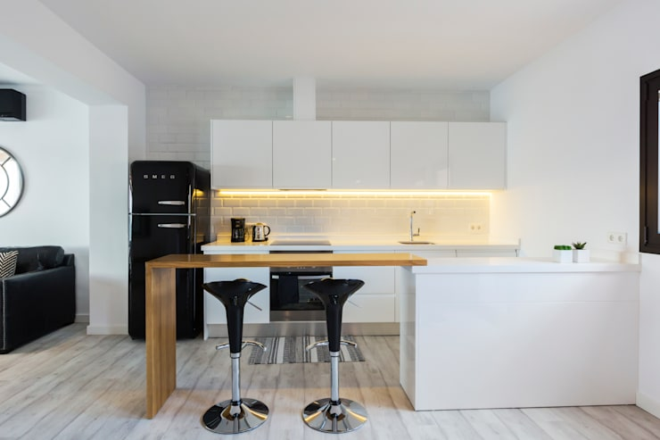 Cozinhas minimalistas por ISLABAU constructora