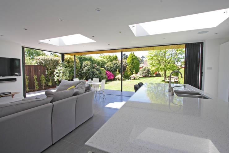 Seamless Indoor-Outdoor Living :  Living room by SunSeeker Doors