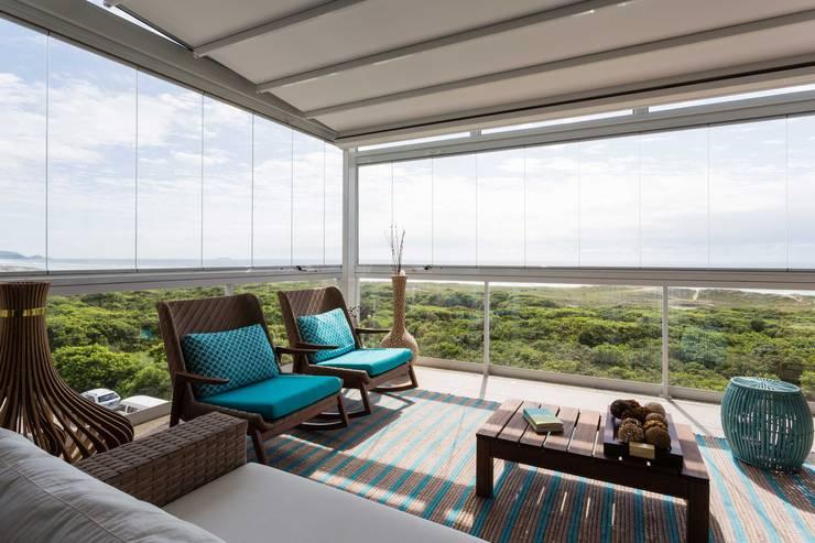 De imóvel padrão à lar dos sonhos de um jovem casal: Terraços  por ROPE Engenharia