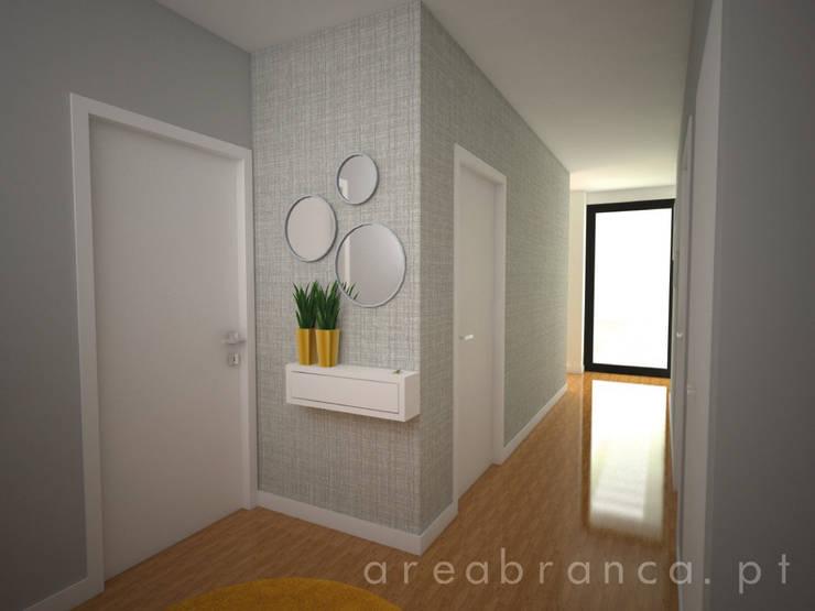 Pasillos y recibidores de estilo  por Areabranca