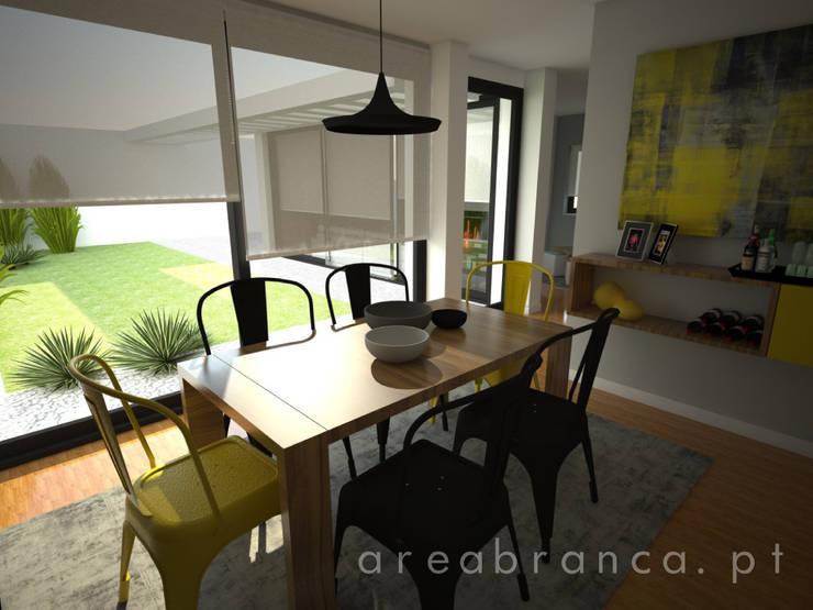 Sala de Estar: Salas de jantar  por Areabranca