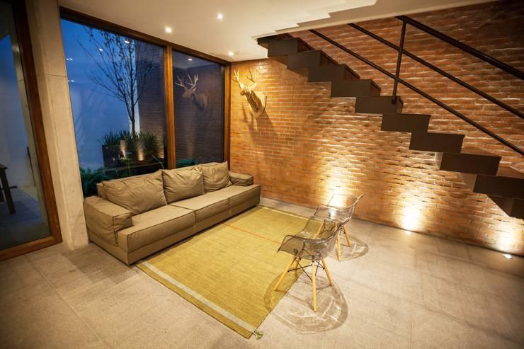Hogar OV. : Salas de estilo  por Lozano Arquitectos