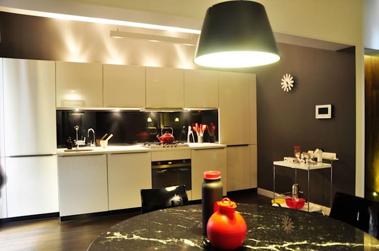 dining and kitchen:  Kitchen by Synectics partners