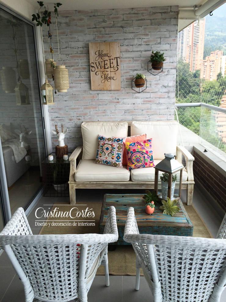Terraza : Balcones y terrazas de estilo  por Cristina Cortés Diseño y Decoración