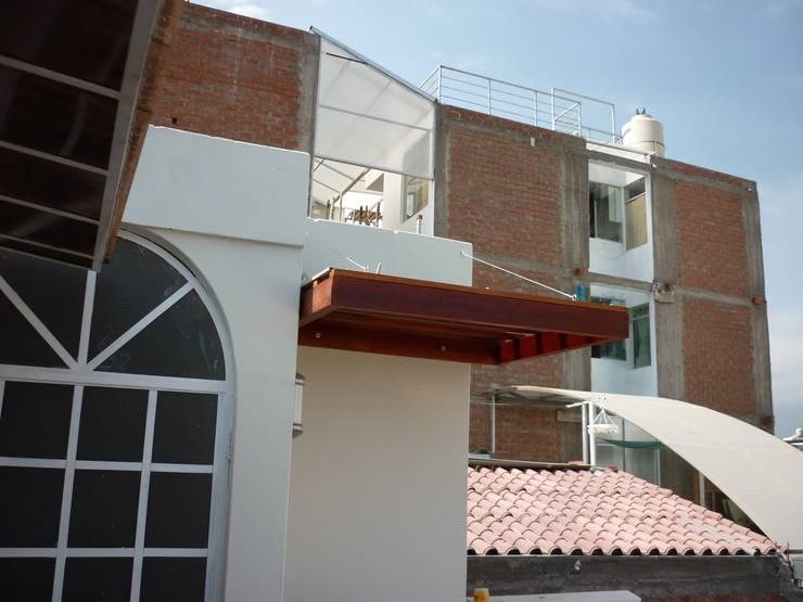 Terraza Balcones y terrazas modernos de Arkimel Moderno
