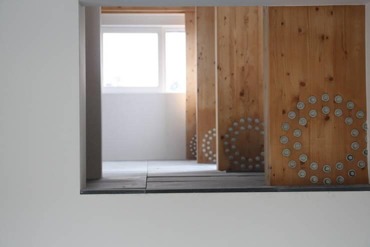 Woning met werkruimte, Homerus kwartier Almere Poort:  Woonkamer door Architectenbureau Jules Zwijsen