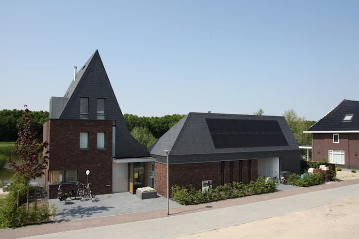 Woning met werkruimte, Homerus kwartier Almere Poort:  Huizen door Architectenbureau Jules Zwijsen