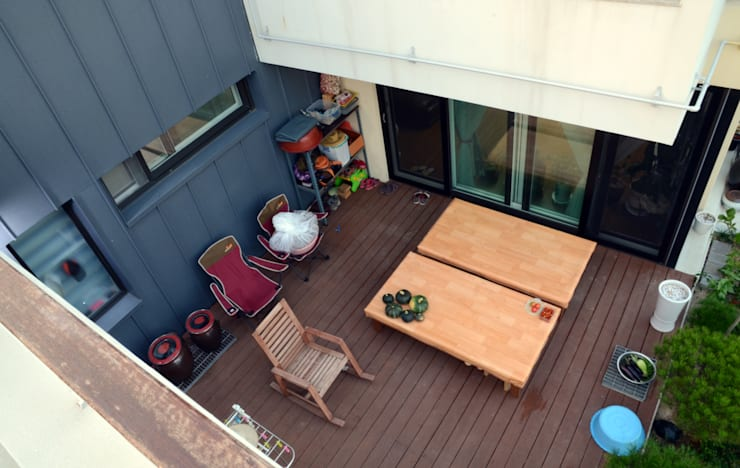 약사동 B:um-house: 건축사사무소 카안  Architect firm KAAN의  베란다