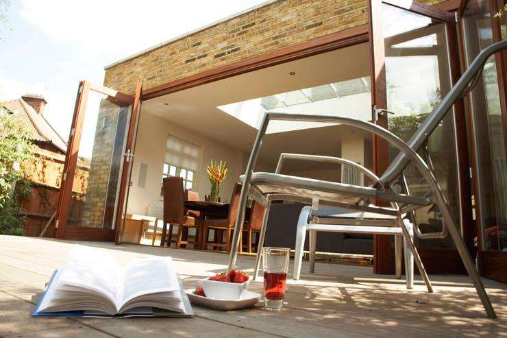 Aumenta a família, aumenta a casa : Jardins  por Architect Your Home