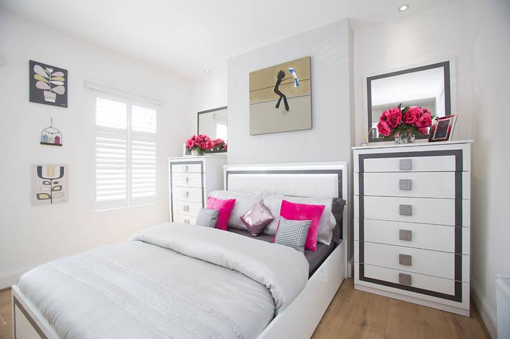 Bedroom After:   by Millennium Interior Designers,