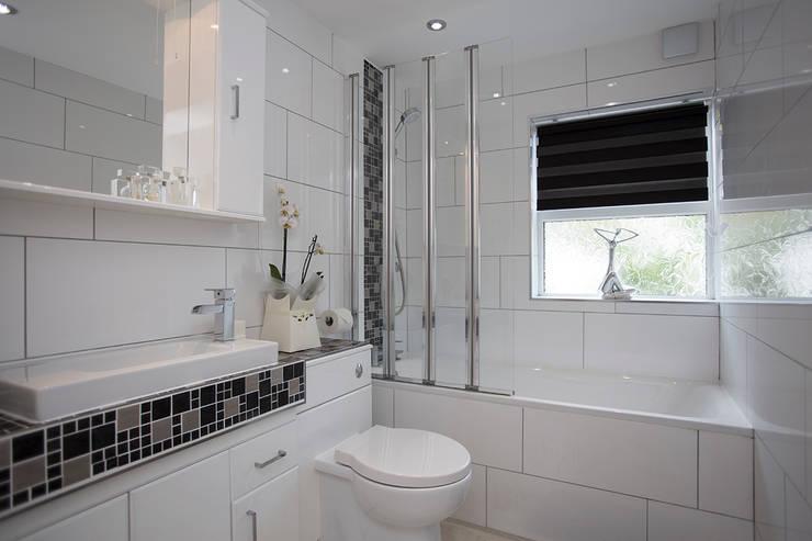 Bathroom After:   by Millennium Interior Designers,