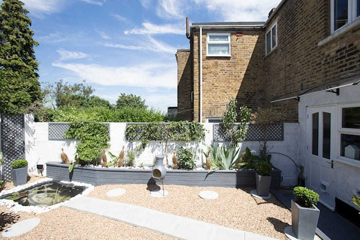 Garden After:   by Millennium Interior Designers