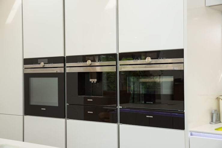 Nobilia Project 11 Gloss lacquer in white with continuous handle rail Modern kitchen by Eco German Kitchens Modern MDF