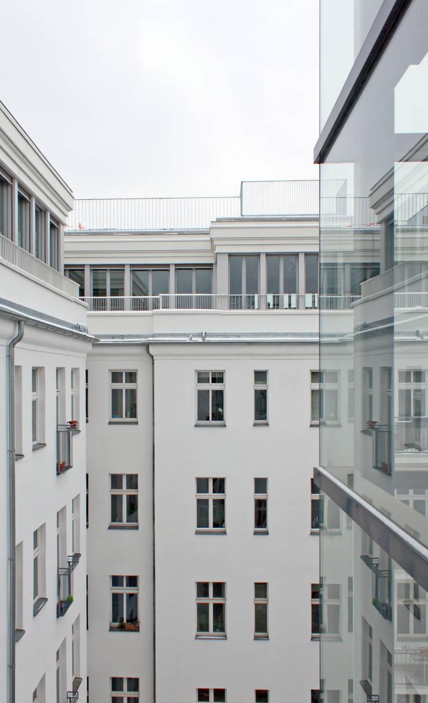 attic expansion:  Houses by brandt+simon architekten