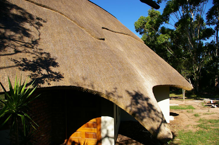 Creative Thatched Roof Design on Residential Home:  Houses by Cintsa Thatching & Roofing