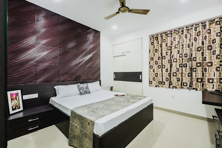 Interiors of Apartment at Parsvnath City Jodhpur:  Bedroom by HGCG Architects