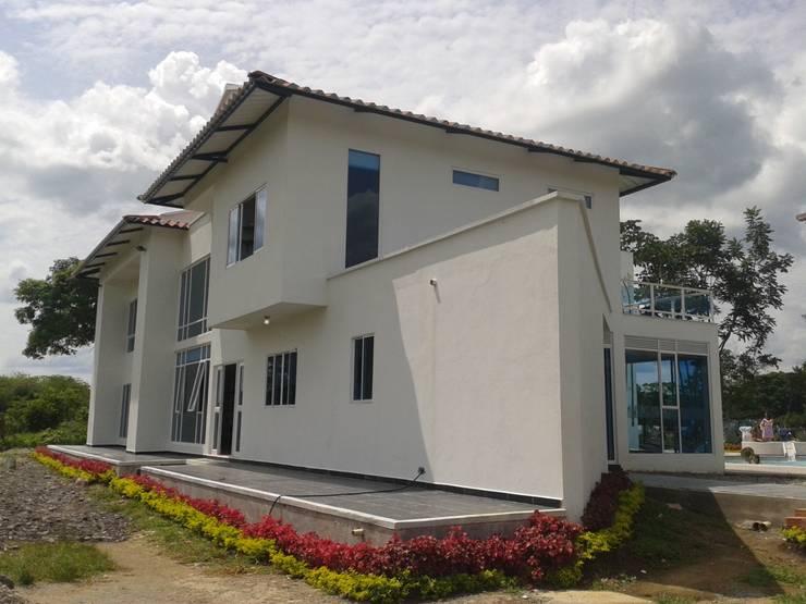Casa Jhony: Casas de estilo  por ARQUITECTOnico, Minimalista