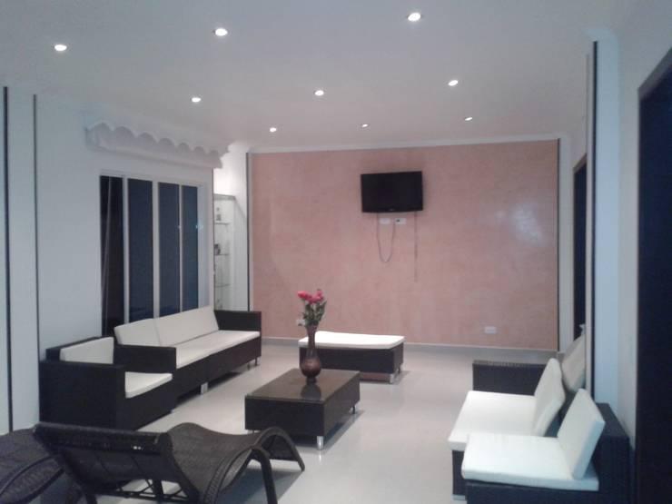 Casa Jhony: Salas de estilo minimalista por ARQUITECTOnico