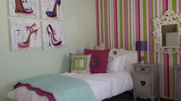 Girly Bedroom:  Nursery/kid's room by Inside Out Interiors