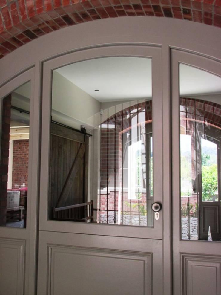 Arched Front Door + Side Lights :  Windows by Window + Door Store Cape