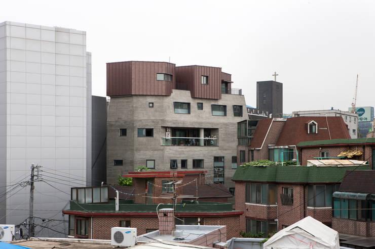 동교동 UFO: 리슈건축 의  주택