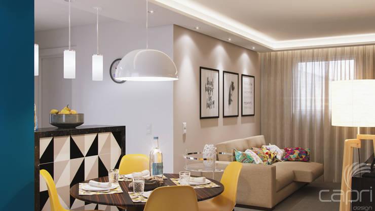 Apartamento pequeno, grande reforma: Salas de estar  por Lúcia Vale Interiores