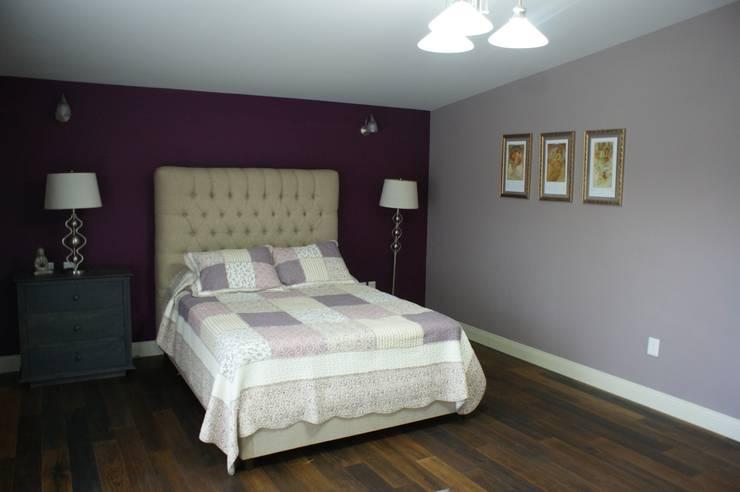 Dormitorios de estilo  de Arquimia Arquitectos