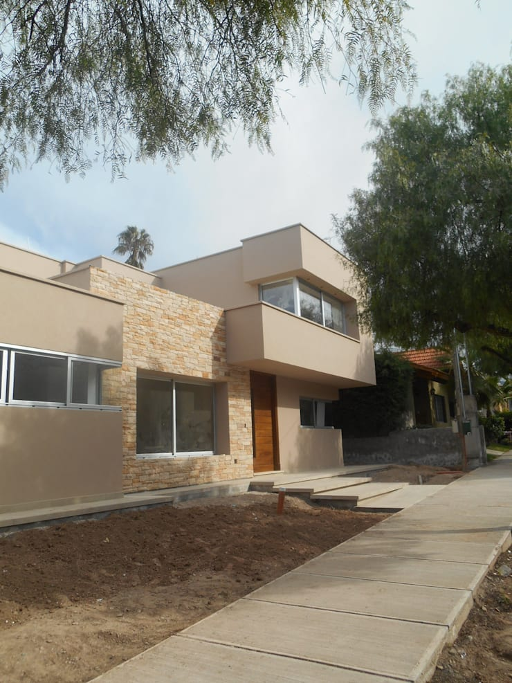 Houses by MABEL ABASOLO ARQUITECTURA, Minimalist