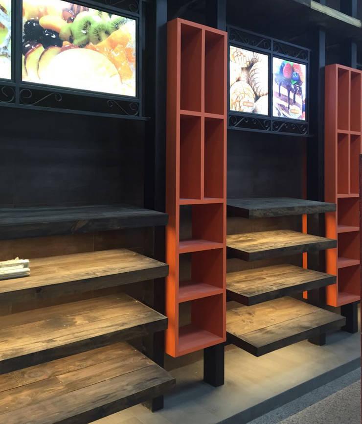 Analquel: Oficinas y tiendas de estilo  por Koencamex