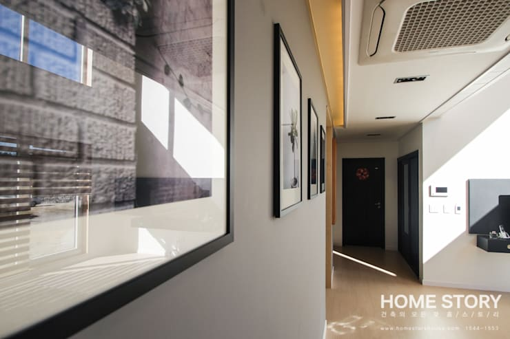 [울진전원주택] 자연속에 빛나는 모던한 디자인: (주)홈스토리의  벽 & 바닥