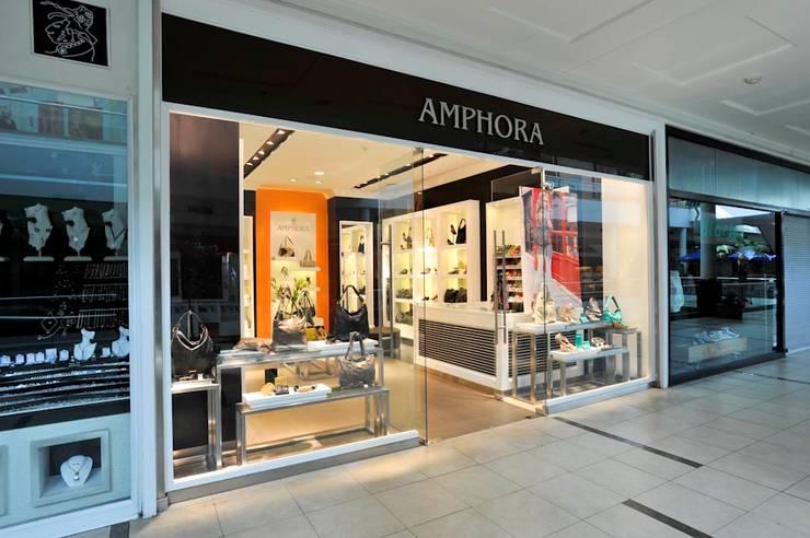 TIENDAS AMPHORA: Espacios comerciales de estilo  por 3 DECO