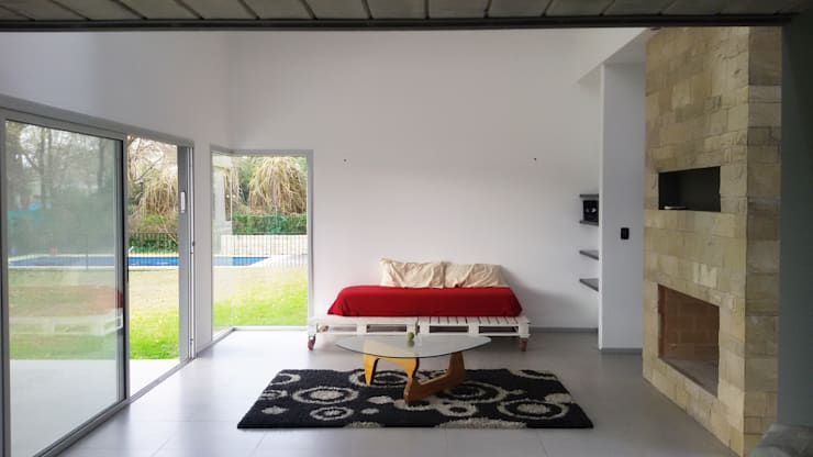 CASA RBL – Estudio FERNANDEZ+MEGO: Livings de estilo  por Estudio Fernández+Mego,