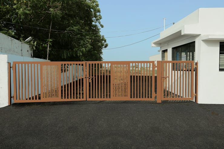 Main gate:  Office buildings by ZEAL Arch Designs,Modern