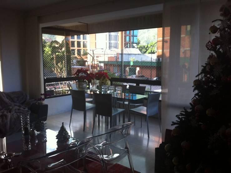 Proyecto Campo Alegre: Comedores de estilo  por THE muebles