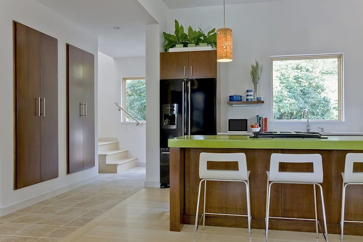 Kitchen island, floating pantry, and stairs to second level:  Kitchen by ZeroEnergy Design