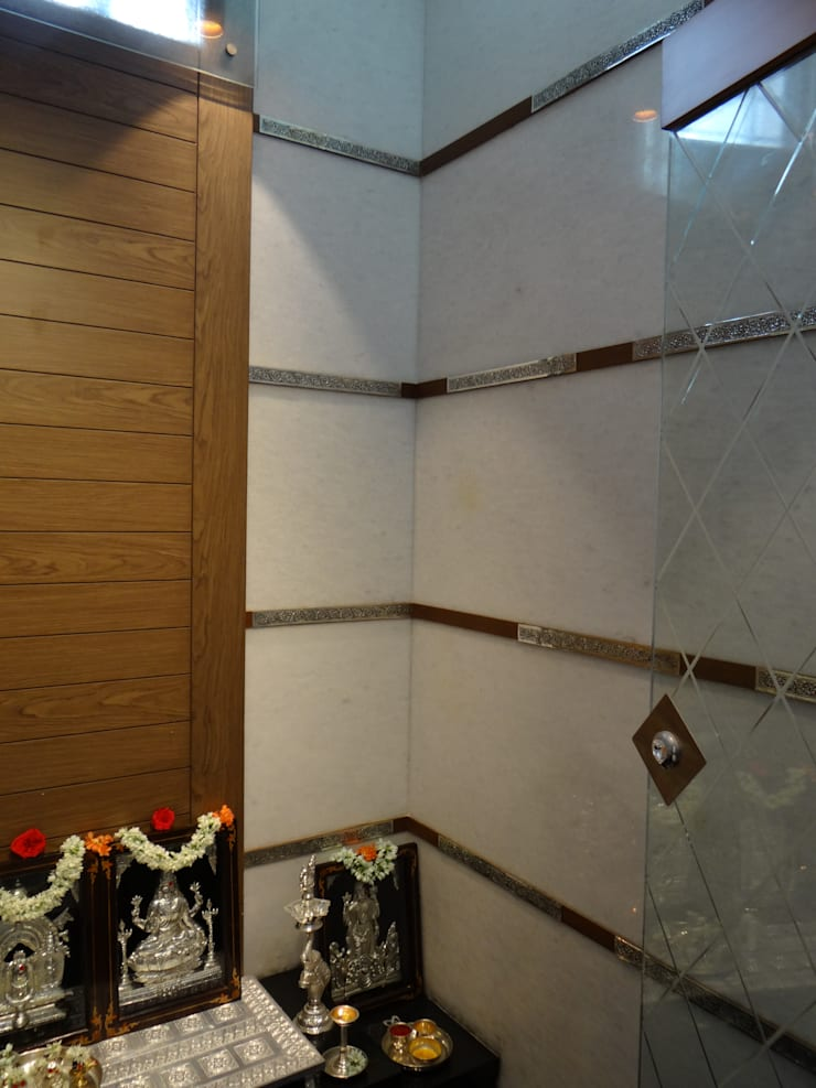 pooja room wall with teak beading and silver motifs:  Corridor & hallway by Hasta architects