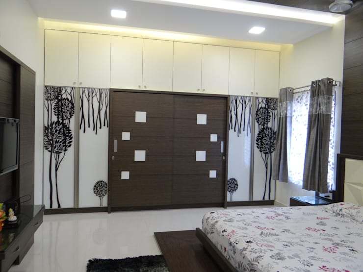 First floor master bedroom wardrobe:  Bedroom by Hasta architects