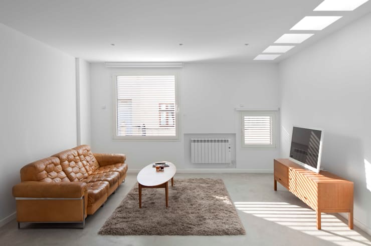 minimalistic Living room by RM arquitectura