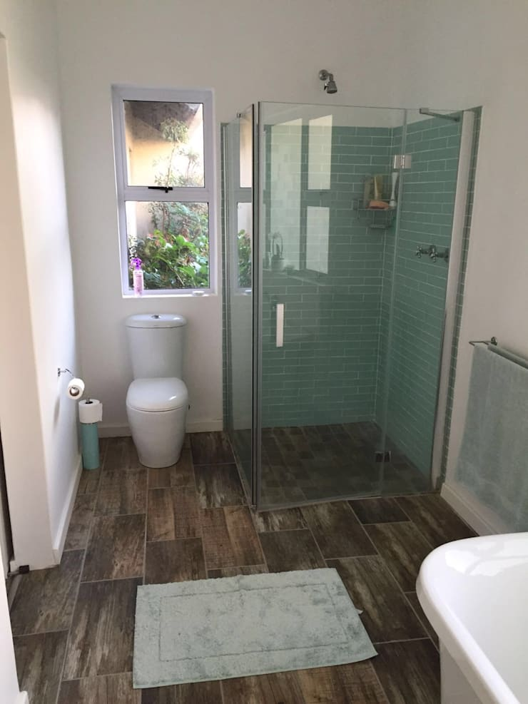 View of completed shower area: rustic  by Urban Dwellers Design Studio, Rustic